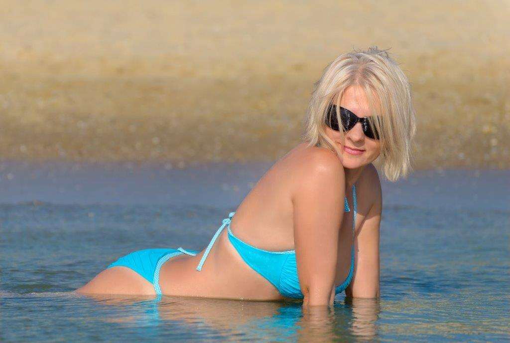 blonde wearing blue bikini in water