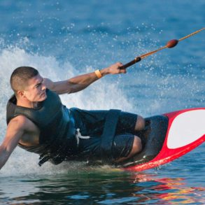 Man doing kneeboarding stunt