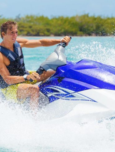 Man on jet ski in lake