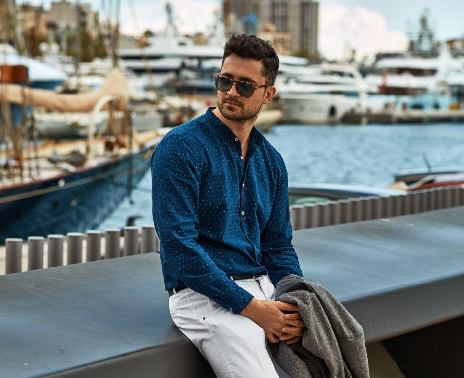 Handsome man on dock illustrating nautical fashion men