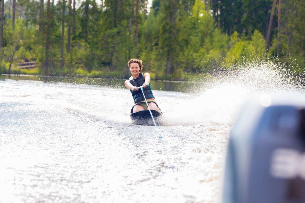 woman riding kneeboard on a lake