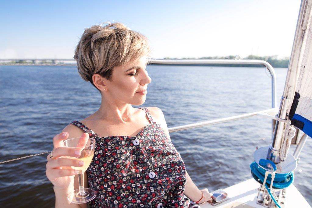 Woman drinking wine on a yacht